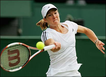 Women's top seed Justine Henin powers a return back to Marion Bartoli