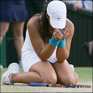 Marion Bartoli sinks to her knees in victory
