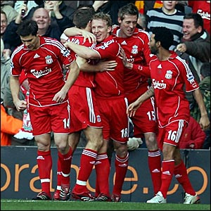 Dirk Kuyt (centre) is congratulated after scoring Liverpool's opener against Chelsea