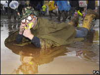 Music fan in mud at T in the Park