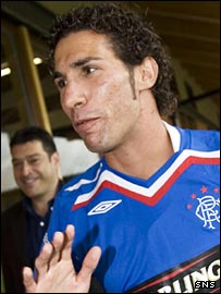 Carlos Cuellar shows his delight at signing for Rangers