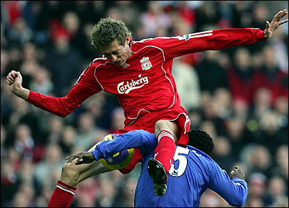 Liverpool's Peter Crouch (top) misses a chance while under pressure from Michael Essien