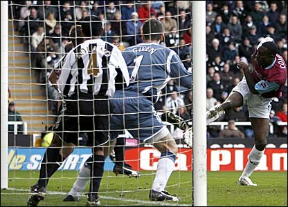 Carlton Cole (right) scores West Ham's opener at Newcastle