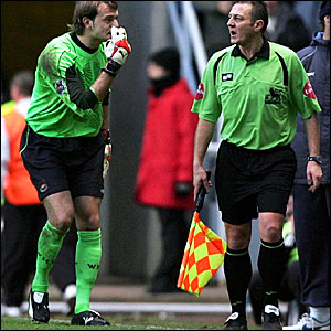 West Ham keeper Roy Carroll (left) indicates that the assistant referee may not have seen an offside Newcastle player