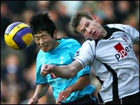 Lee Young-Pyo challenges Fulham's Brian McBride