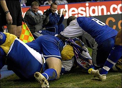 Reading goalscorer Shane Long celebrates with Kingsley Royal, the Reading mascot, after scoring the opening goal