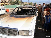 Burned car at scene of fighting in Basra