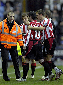 Sheffield United winger Keith Gillespie (centre) is escorted from the pitch