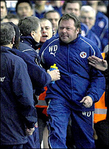 Reading coach Wally Downes (right) moves towards Sheffield United manager Neil Warnock (centre)
