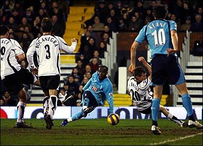 Pascal Chimbonda (centre) scores Tottenham's equaliser at Craven Cottage