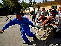 Iraqis bring a wounded man into a hospital in the city of Kirkuk - 7/7/07