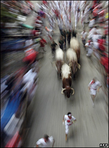Zoom blur shot of bulls running after crowd, Saturday 7 July 2007