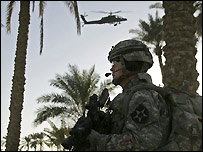 US soldier with military helicopter overhead - file photo