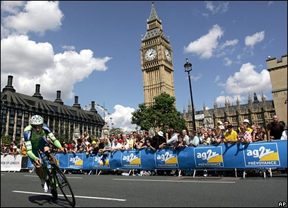 A cyclist passes near Big Ben