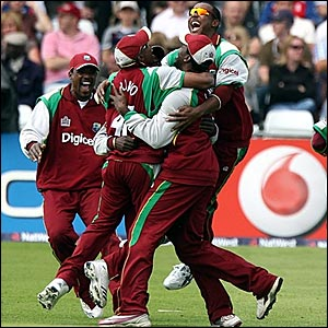 West Indies players celebrate dismissing Kevin Pietersen