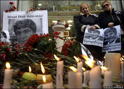 Candles and photographs in memory of Hrant Dink