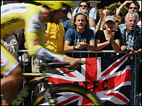 Fans encourage on a rider during the Tour de France prologue