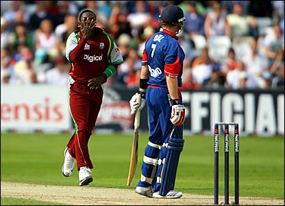 Fidel Edwards (left) celebrates after dismissing Ian Bell