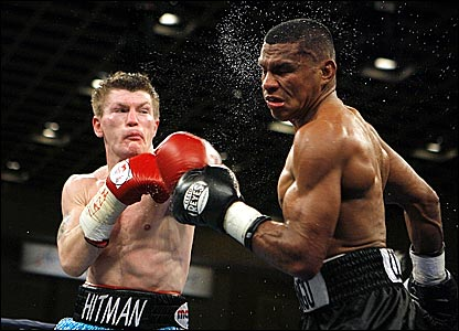 Ricky Hatton (left) connects with a left in round four