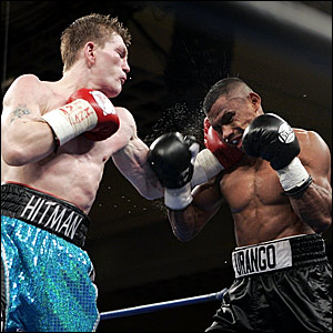 Ricky Hatton (left) lands a rare punch in the tenth round