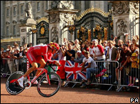 Fans cheered the riders outside Buckingham Palace