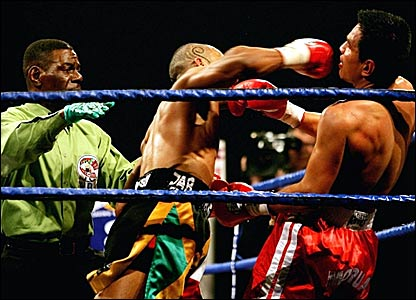 The referee moves in to stop the fight between Junior Witter (centre) and Arturo Morua (right)