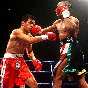 Junior Witter (right) lands a punch on Mexico's Arturo Morua