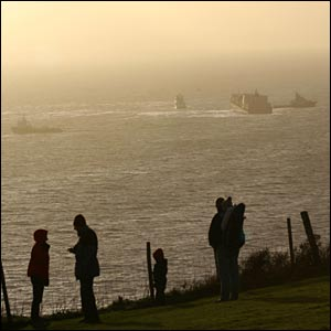 People observing the MSC rescue operation