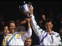 Jo Durie and Jeremy Bates lift the 1987 mixed doubles trophy