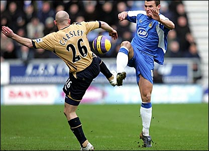 Wigan's Lee McCullloch (right) battles for the ball with Everton's Lee Carsley
