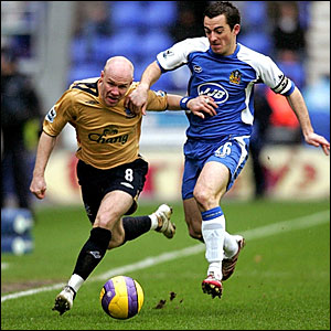Everton's Andrew Johnson (left) and Wigan's Leighton Baines compete for the ball