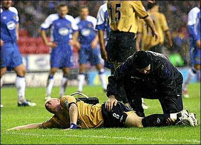 Everton striker Andy Johnson receives attention from the physio