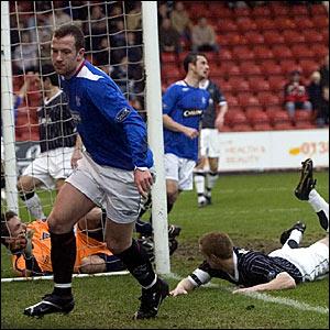 Charlie Adam (left) wheels away to celebrate scoring for Rangers against Dunfermline