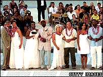 Brides and grooms line up during a wedding ceremony for 33 couples at the Mandalay Bay Resort Casino in Las Vegas