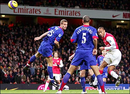 Thierry Henry (right) heads in Arsenal's winner against Manchester United