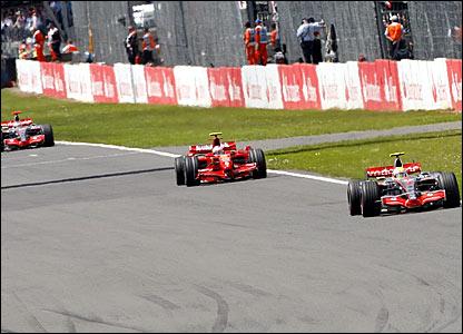 (-l-r) Fernando Alonso chases Kimi Raikkonen and Lewis Hamilton