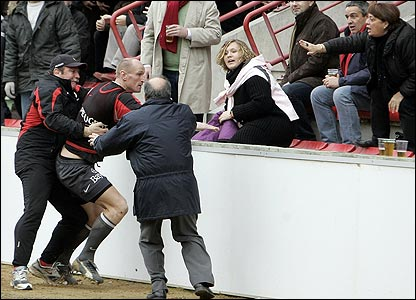 Toulouse player Gareth Thomas had to be restrained in front of Ulster supporters