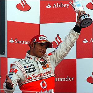 Lewis Hamilton with his third-placed trophy