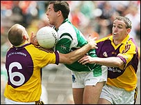 Ryan Keenan of Fermanagh comes under pressure from Philip Wallace and Colm Morris of Wexford