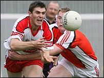 Derry's Mark Lynch in action against Ciaran McKeever of Armagh