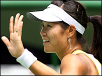 China's Li Na waves goodbye to the Australian Open