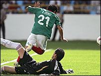 Mexico's Nery Castillo is felled by Paraguay keeper Aldo Bobadilla