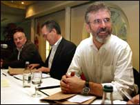 Sinn Fein President Gerry Adams (right) at a republican meeting on policing in Northern Ireland in Toome, Co Antrim.