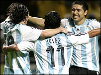 (L-r) Lionel Messi, Carlos Tevez and Juan Riquelme celebrate