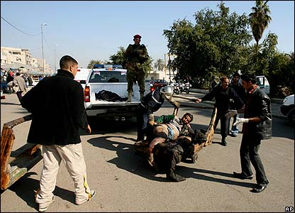 An injured man is taken away near the site of the blast