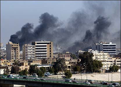 Smoke rises over Baghdad after the explosions
