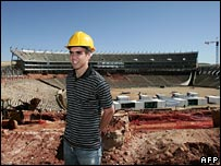 German football player Philip Lahm visiting the worksite of Soccer City in the township of Soweto