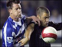 Nicky Shorey challenges Chelsea's Joe Cole