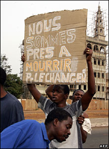 "A protester holds a placard which reads: ""We are ready to die for change"""