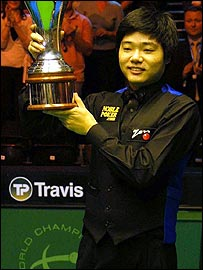Ding Junhui lifts up the 2005 UK Championship trophy